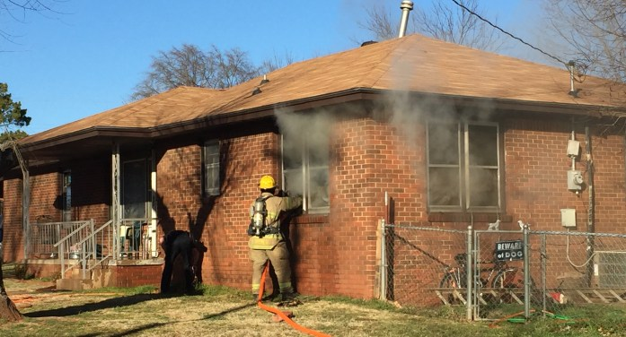 Candle sparks house fire; three fire departments respond