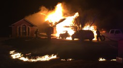 Family of four escape burning home; high winds prove to be havoc