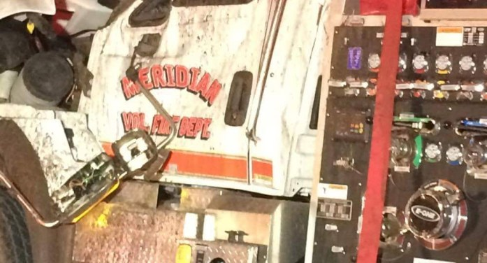 Fire engine rolls over responding to house fire
