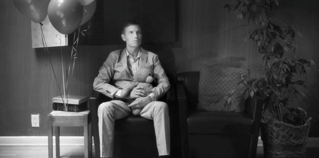 The Artist (Hunter Lee Hughes) waits for news. Photo by Michael Marius Pessah.