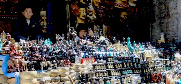 Hawker selling Buddhist icons and figurines, Thamel, Nepal