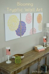 This large blooming tryptic wall art looks like it came from a gallery but its a DIY project! Easy to make with stencils and plain canvases. H2OBungalow #stencils