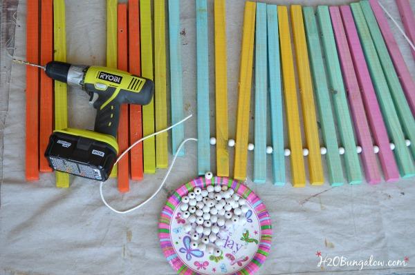 string beads in between slats on wood doormat H2OBungalow