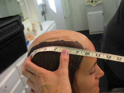 I'm taking more measurements for the wig maker.