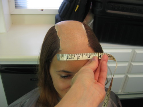 Measuring a double during a hair test. have to send info to wig maker to build several look hair pieces to lay on top of partial bald cap.