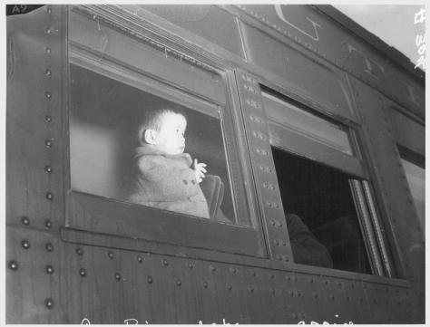 Clem Albers. Lone Pine, California. 4/1/42 A young evacuee of Japanese ancestry arrives here by train prior to being transferred by bus to Manzanar, now a War Relocation Authority center
