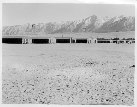 Dorothea Lange. Manzanar, California. 6/30/42. View of barrack homes at this War Relocation Authority center, showing outside entrances.