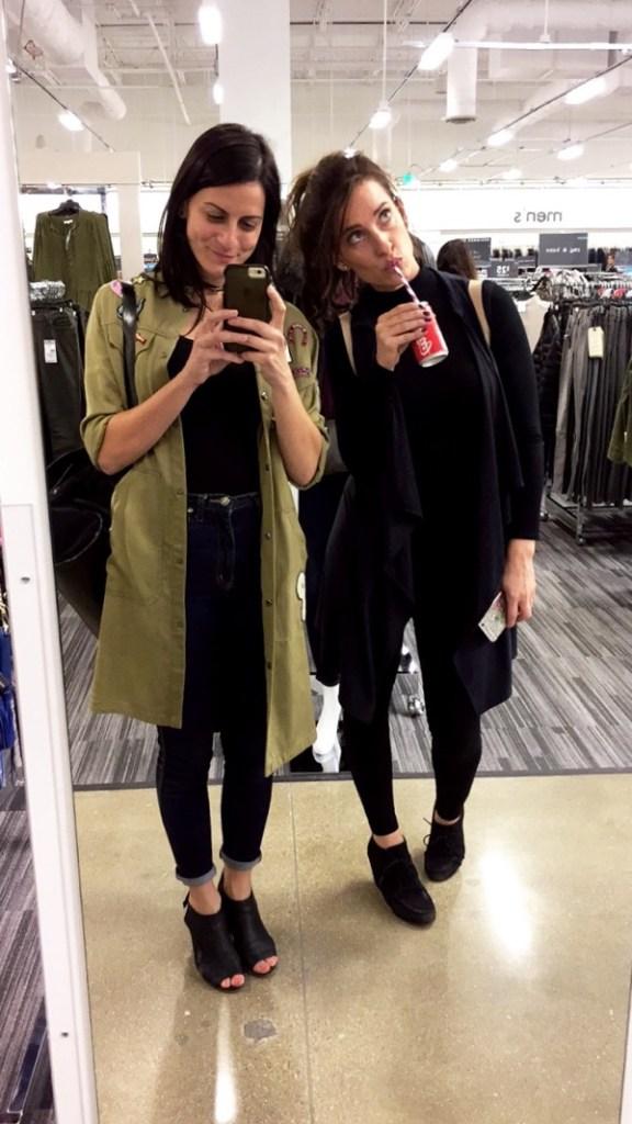 friends in a mirror selfie drinking coke