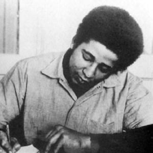George-Jackson-writing-San-Quentin-web