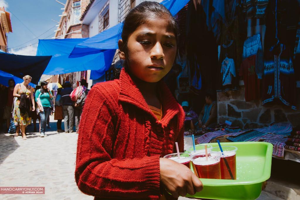 little girl selling drinks tarabuco bolivia