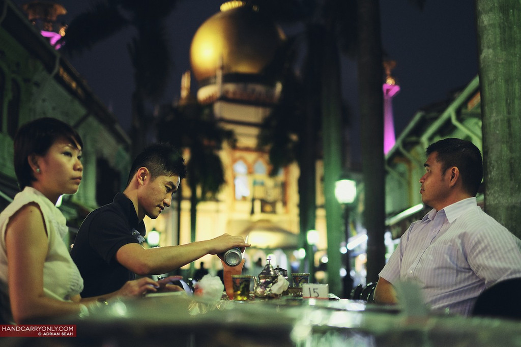 diners in front of mosque