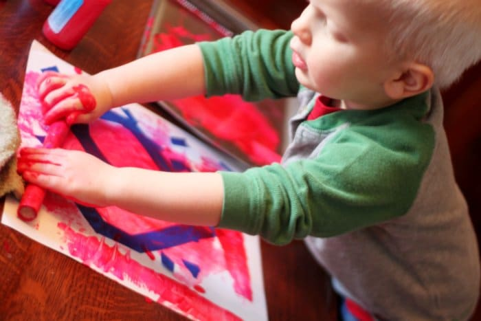 Rolling in the Paint to Make Valentine Art for Toddlers