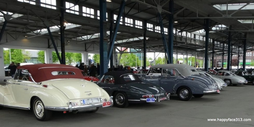 a Mercedes 300 SL Roadster enveloped by his bigger sisters