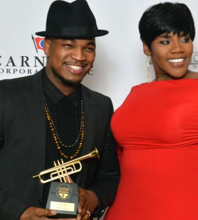 neo and guest with trumpet award