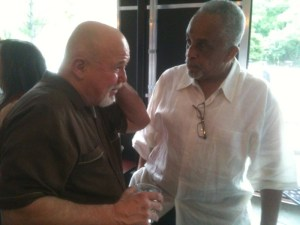 Maynard Eaton chatting with his long time friend and follow journalist Tom Houck at an Atlanta Press Club Party in 2011. Photo Credit: (c) 2011 Harold Michael Harvey