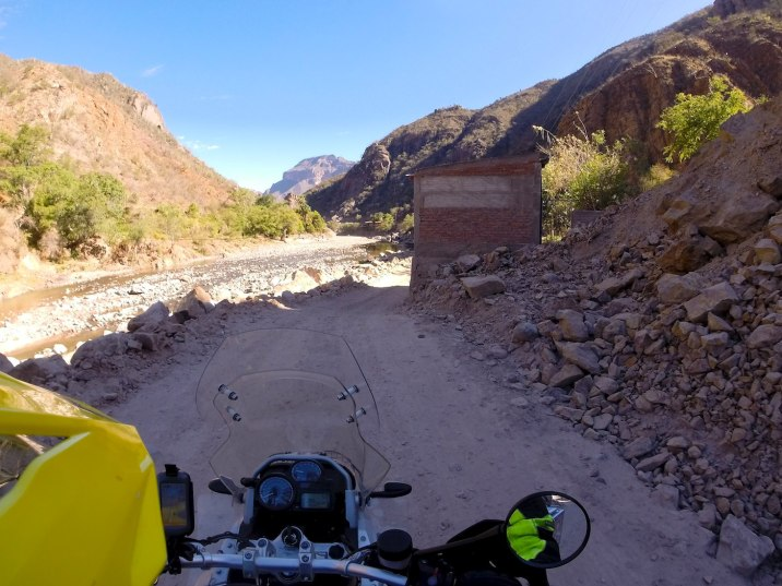 The first dirt stretch out of town is flat and follows the river; mostly gravel but sandy in some places.