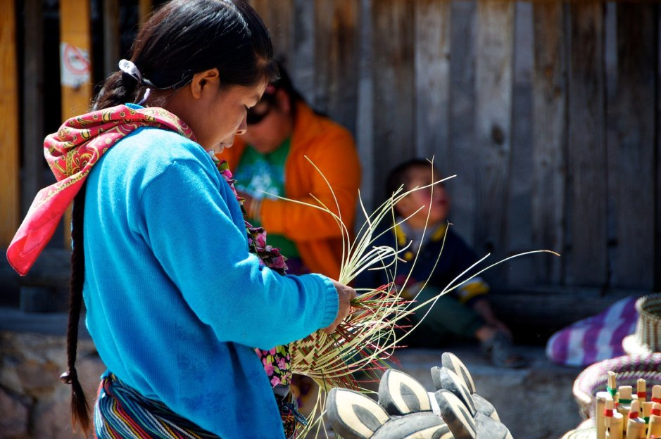 A Tarahumara woman weaves in Divisadero.