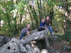 Jessica and her boys climbing on the Dolmen (ancient, sacred rocks put together by the ancient people of Europe.  The most prominent and known Dolmen is Stonehenge) near their castle in France.