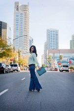 An Dyer wearing Zara Swiss Dot Shirt, Frankie B Wide Leg Jeans, Forever 21 Suedette Belt &amp; Gold Cuff, Jessica Simpson Dany Shoes, Jeffrey Lazaro Shell Print Clutch, Louis Vuitton Transparent Monogram Inclusion Translucide Pendant Necklace, Banana An Turquoise Ring