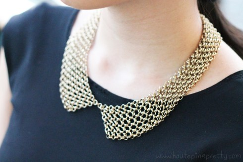 An Dyer wearing TopShop Gold Mesh Collar Necklace | Zara Peplum Dress With Frill At The Waist | Gold Double Cuffs | Jimmy Choo Corsica Sandals circa FW'09 | Jeffrey Lazaro White Pebbled Leather Foldover Clutch | Decree Metallic Stone Ring