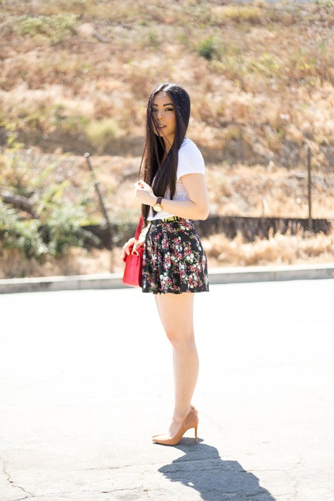 An Dyer wearing ShoeMint Lulu Nude Suede Pump, Sole Society Britt Red Satchel, BCBGeneration DIY Custom Affirmation Bracelets as a Belt, Michael Stars VNeck Tee, Forever 21 Floral Shorts