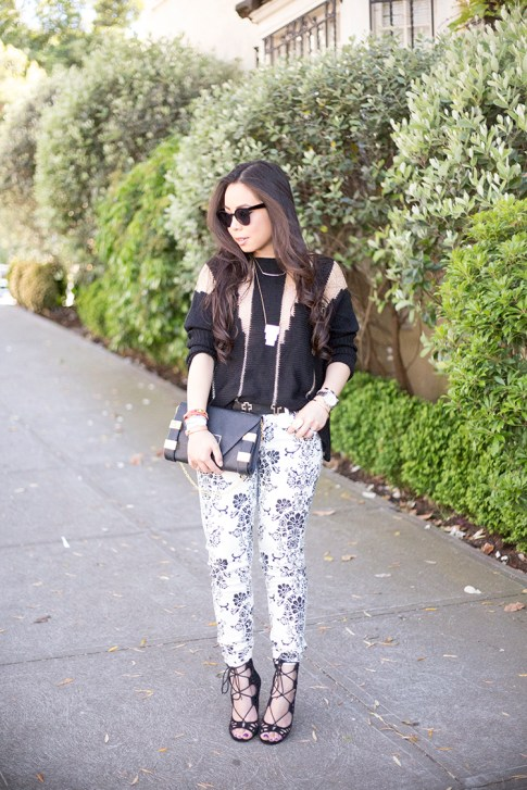 An Dyer wearing Fidelity Denim White Floral Jeans, ShoeMint Romy, ASOS Cross Belt, Rehab Black Sheer Mesh Sweater