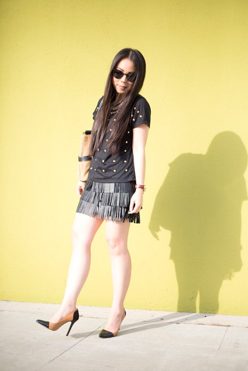An Dyer wearing Lovers & Friends Kiss Me Top, Sole Society Blakeley Nude Black Pumps, Zara Leather Fringe Skirt, Olivia Joy Swanky Straw Satchel, Black Cat Eye Metal Frame Sunglasses