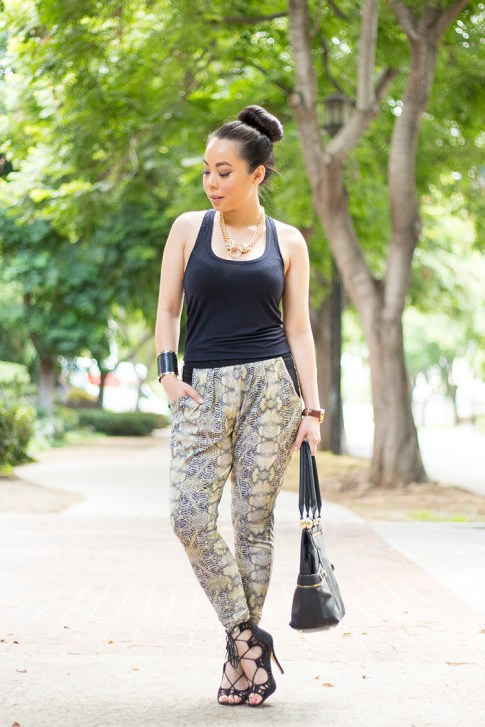 An Dyer wearing ShoeMint Romy, Evleo Baggy Snakepint Leggings, Olivia Joy Swanky Satchel, JewelMint Cobra Cuff, Jockey Rachel Zoe Modal Tank