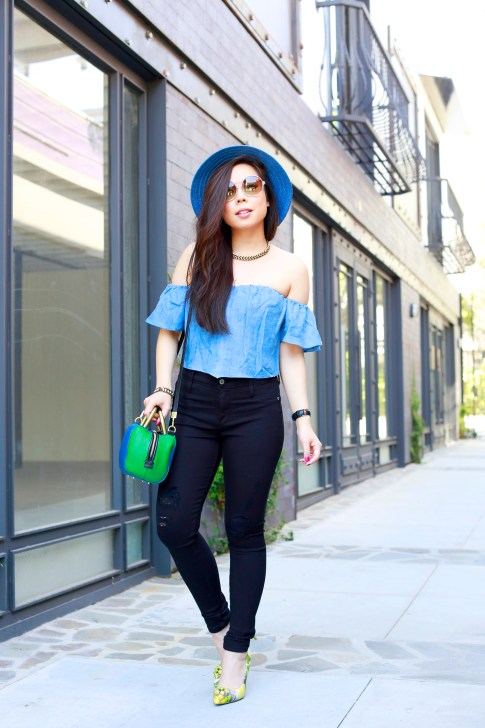 An Dyer wearing Blue Fedora with Guess denim off the shoulder top and james jeans