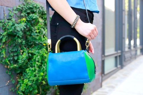 An Dyer wearing Hare Hart Blue Green Crossbody with Loren Hope Bracelet