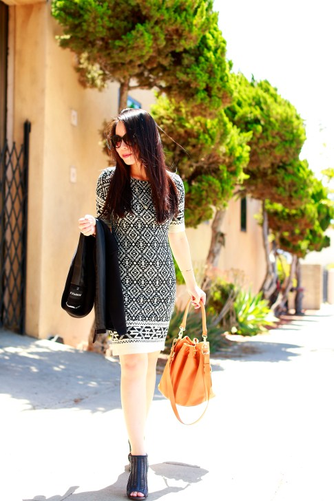 An Dyer wearing Karen Kane dress with Louise et Cie Sheree Woven Leather Sandals and Ora Delphine Bucket Bag