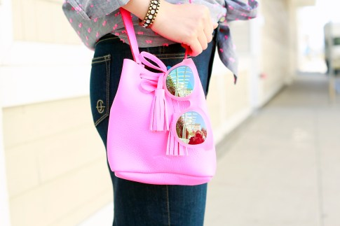 An Dyer wearing TOMS Travelers Pink Sunglasses with Schaffer Neon Pink Mini Bucket Bag