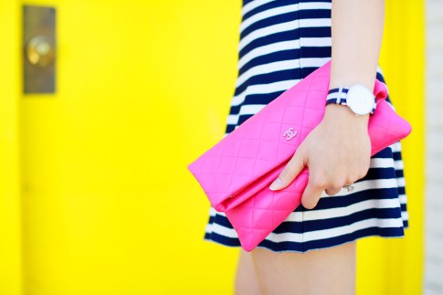 An Dyer carrying Chanel Hot Pink Foldover Clutch
