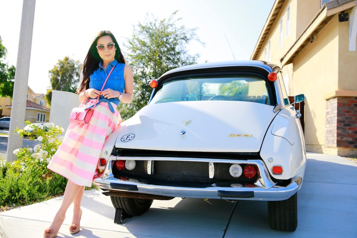 An Dyer wearing Chicwish Candy Pink Striped Full Midi Skirt and Louis Vuitton Louise Corail, with 1971 Citroen DS 21