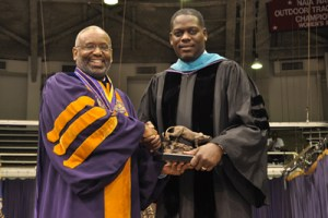 Prairie View A&M University President George C. Wright gives Dallas District Attorney Craig Watkins a gift. (Colby Walker)
