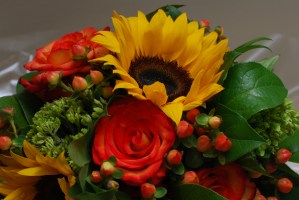 Closeup of wedding bouquet of sunflowers and roses