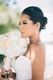 Beautiful Toronto Bride holding Floral bouquet with beaded accents
