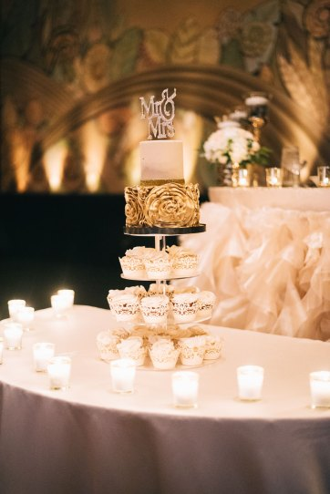 Elegant wedding cake with crystal topper and cupcakes in Toronto