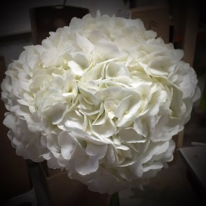 All white floral bouquet with beads