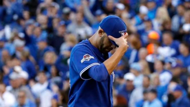 Toronto Blue Jays starting pitcher David Price looks down as he walks off the field after being relieved in the seventh inning in Game 2 of baseball's American League Championship Series against the Kansas City Royals, Saturday, Oct. 17, 2015, in Kansas City, Mo. (AP Photo/Matt Slocum)