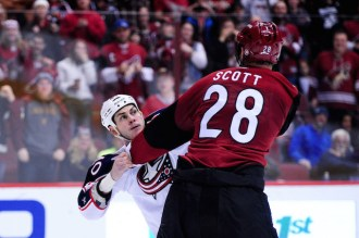 Dec 17, 2015; Glendale, AZ, USA; Arizona Coyotes left wing John Scott (28) and Columbus Blue Jackets right wing Jared Boll (40) fight during the second period at Gila River Arena. Mandatory Credit: Matt Kartozian-USA TODAY Sports
