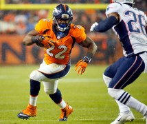 Denver Broncos running back C.J. Anderson (22) runs as New England Patriots cornerback Logan Ryan (26) defends during the first half of an NFL football game, Sunday, Nov. 29, 2015, in Denver. (AP Photo/Jack Dempsey)