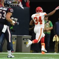 Kansas City Chiefs running back Knile Davis (34) returns a kickoff for a touchdown as Houston Texans inside linebacker Max Bullough (53) chases him during the first half of an NFL wild-card football game Saturday, Jan. 9, 2016, in Houston. (AP Photo/Eric Christian Smith)