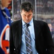 UNIONDALE, NY - NOVEMBER 29: Head coach Jack Capuano of the New York Islanders leaves the ice following a 5-0 defeat against the Detroit Red Wings at the Nassau Veterans Memorial Coliseum on November 29, 2013 in Uniondale, New York. (Photo by Bruce Bennett/Getty Images)