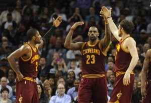 Feb 3, 2016; Charlotte, NC, USA; Cleveland Cavaliers forward LeBron James (23) gets a high five from his teammates guard Kyrie Irving (2) and forward Kevin Love (0) after scoring during the second half of the game against the Charlotte Hornets at Time Warner Cable Arena. Hornets win 106-97. Mandatory Credit: Sam Sharpe-USA TODAY Sports
