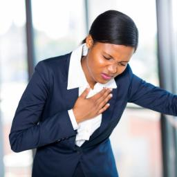 a-woman-experiencing-chest-pain