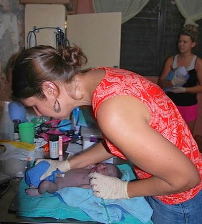 Jen Checking Baby