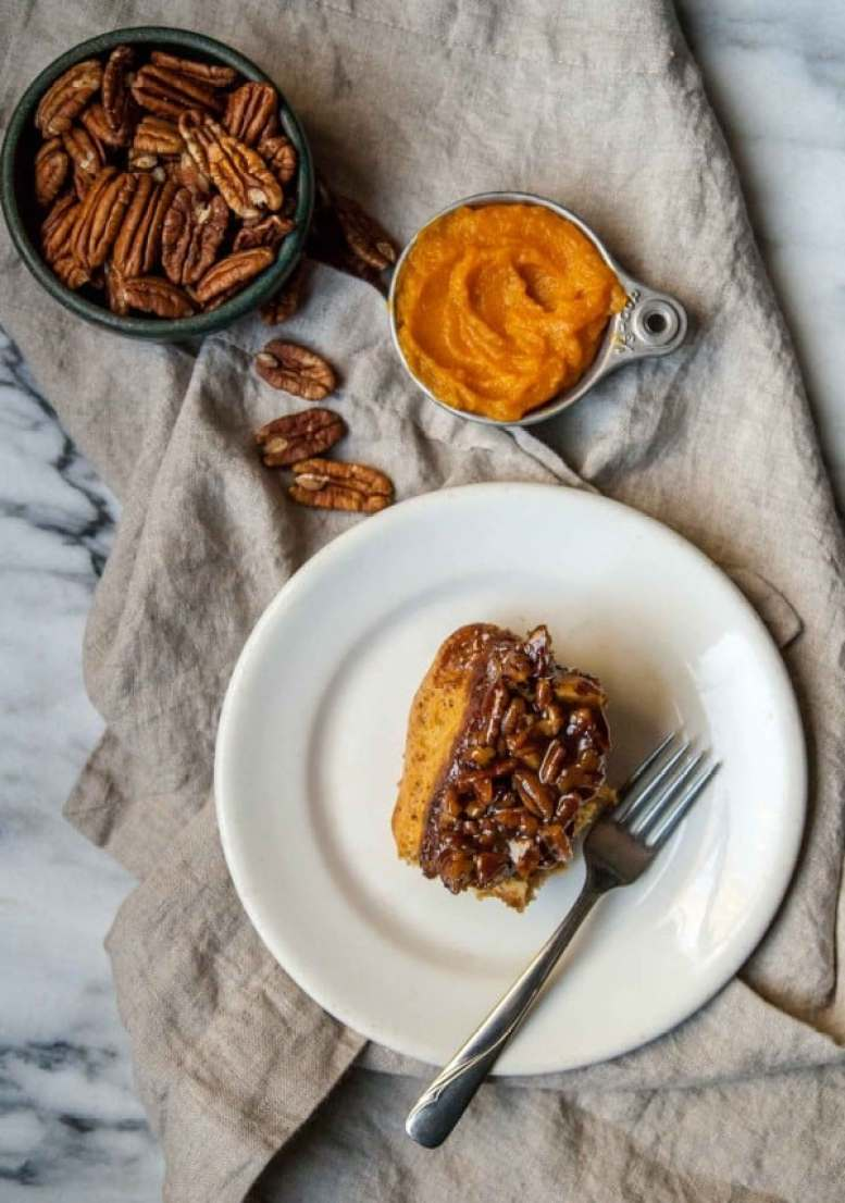Fluffy and sweet vegan sticky buns flavored with pumpkin and spices, topped with a vanilla bean pecan glaze!