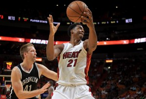 MIAMI, FL - OCTOBER 11:  Hassan Whiteside #21 of the Miami Heatshoots over Justin Hamilton #41 of the Brooklyn Nets during a preseason game  at American Airlines Arena on October 11, 2016 in Miami, Florida. NOTE TO USER: User expressly acknowledges and agrees that, by downloading and or using this photograph, User is consenting to the terms and conditions of the Getty Images License Agreement.  (Photo by Mike Ehrmann/Getty Images)