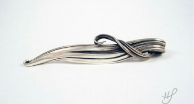 Silver Pendant with a Flowing Shape